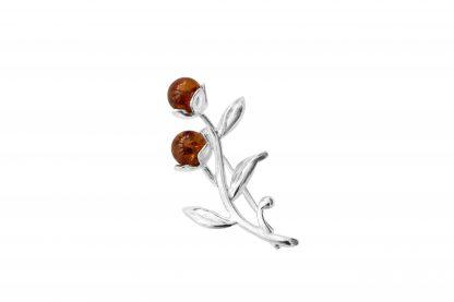 Elegantná jantárová brošňa zo striebra a baltického jantáru predstavujúca púčiky kvetov